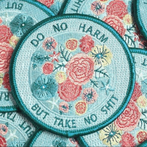 """Do no harm but take no shit"" round clothes label from Tender Ghost"